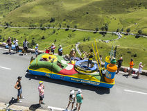 Teisseire Truck. Col de Peyresourde,France- July 23, 2014: Teisseire truck on the road to Col de Peyresourde in Pyrenees Mountains in front of excited spectators stock photo