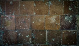 Teja vieja en el piso y la pared imagen de archivo libre de regalías