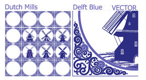 Tejas azules de la cerámica de Delft (modelo) con las imágenes holandesas del molino de viento Fotografía de archivo