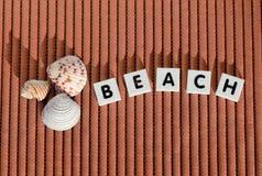 Tejas de la letra de la playa Imágenes de archivo libres de regalías