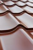 Tejas de tejado del metal de Brown Fotografía de archivo libre de regalías