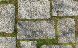 Tejas medievales del exterior del granito del castillo viejo sucio de la terraza Fotos de archivo libres de regalías