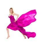 Tejido rosado vestido del vuelo de la mujer joven Fotografía de archivo libre de regalías