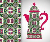 Tekanna med den dekorativa prydnaden och den sömlösa modellen arkivbild