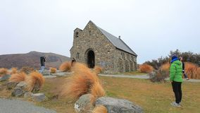 TEKAPO NEW ZEALAND - SEPTEMBER1,2015 : tourist taking a photograph church of good shepherd most popular traveling destination in t. Ekapo town southland new stock video