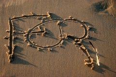 Teken op een strand Stock Foto's