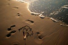 Teken op een strand Royalty-vrije Stock Fotografie