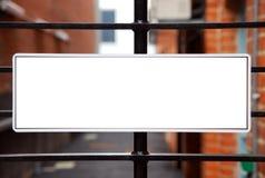 Teken op poort Stock Fotografie