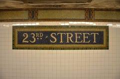 Teken van de 23ste metro van de Straat in de Tegel van het Mozaïek, NYC Royalty-vrije Stock Afbeeldingen