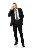 Teken van de zakenman het gesturing idiot stock foto