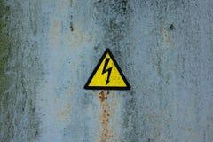 Teken van het symbool van de gevaarshoogspanning Stock Foto