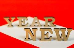 Teken van houten brieven nieuw jaar Stock Afbeeldingen