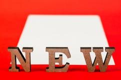 Teken van houten nieuwe brieven Royalty-vrije Stock Afbeeldingen