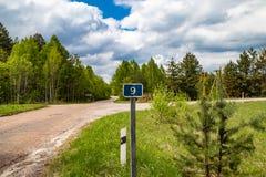 Teken van kilometers, informatie voor reizigers door auto worden gereist die stock foto's
