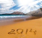 Teken van nieuw jaar op het overzeese strand Stock Foto
