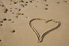 Tekening van een hart op zandig Stock Afbeelding