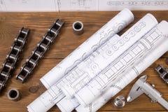 Tekeningen, die hulpmiddelen en details van kettingen op de lijst meten stock foto