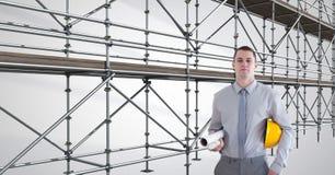 tekniker med hatten på hans arm framme av materialet till byggnadsställning 3D Royaltyfri Fotografi