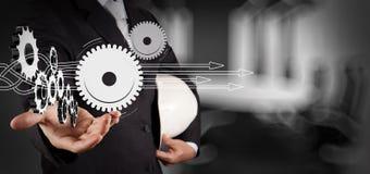 Teknikerhand som visar kugghjulet 3d till framgångbegreppet Arkivfoto