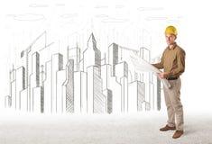 Teknikerman med byggnadsstaden fotografering för bildbyråer