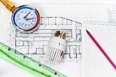Teknikuppvärmning Begreppsuppvärmning Projekt av uppvärmning för hus Royaltyfri Foto