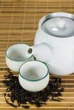 Tekopp med tebladet Arkivfoto