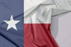 Teksas tkaniny flaga zagniecenie z biel przestrzenią i krepa fotografia stock