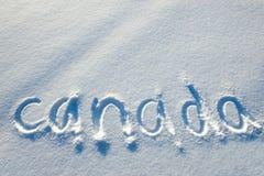 Tekst die op sneeuw wordt geschreven. Royalty-vrije Stock Foto's