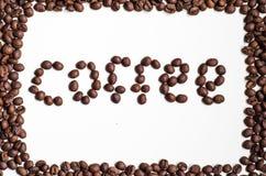 Tekst door koffiebonen Royalty-vrije Stock Foto's