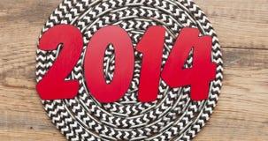 Tekst 2014 en kabelbroodje Stock Foto's