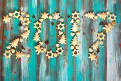 Tekst - het nieuwe die jaar van 2017, van koekjes en decoratie wordt gemaakt Stock Foto's