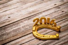 Tekst 2016 met gouden hoef Stock Fotografie
