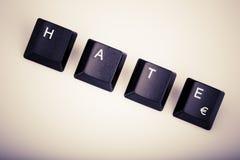 Tekst nienawiść tworząca z komputerowymi klawiaturowymi kluczami Zdjęcia Stock