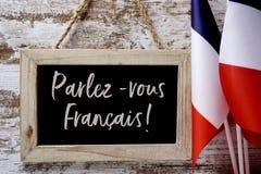 Tekst parlez-vous francais? spreekt u het Frans? stock foto's