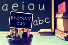 Tekst piśmienności dzień w chalkboard w sala lekcyjnej, filtrującej Obraz Royalty Free