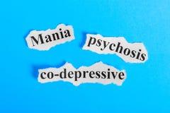 Tekst van de manie de mede-depressieve psychose op papier Word Manie mede-depressieve psychose op een stuk van document Het beeld stock foto's