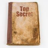 Teksta Ściśle Tajny Pisać na starym brudzi książkę Odgórny widok zdjęcie royalty free