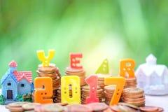 2017 teksta numerowy miejsce na monetach z domem Obrazy Stock