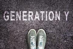 Teksta pokolenie Y pisać na asfalcie z butami Fotografia Royalty Free