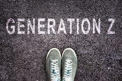 Teksta pokolenie Z pisać na asfalcie z butami, pokolenia Z pojęcie Zdjęcia Stock