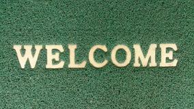 Teksta powitanie na zielonej tło teksturze Fotografia Royalty Free