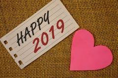 Teksta znak pokazuje Szczęśliwy 2019 Konceptualnej fotografia nowego roku świętowania otuch Congrats MessageNotebook Motywacyjnej Obrazy Royalty Free
