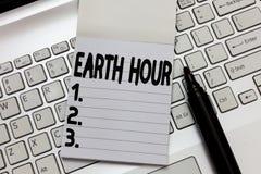 Teksta znaka seansu ziemi godzina Konceptualnej fotografii Globalny ruch wezwanie dla wielkiej akcji na zmiana klimatu zdjęcia stock