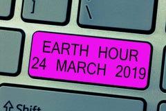 Teksta znaka seansu ziemi godzina 24 Marzec 2019 Konceptualna fotografia Świętuje trwałości Save planeta Zaświeca Daleko obrazy stock
