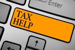 Tekstteken die Belastingshulp tonen Conceptuele fotohulp van de verplichte bijdrage tot de van het de opbrengsttoetsenbord van de stock foto's