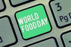 Tekstteken die de Dag van het Wereldvoedsel tonen De conceptuele dag van de fotowereld van actie gewijd aan het aanpakken van glo stock foto