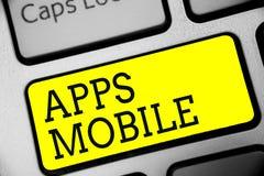 Tekstteken die Mobiele Apps tonen Conceptueel die fotocomputerprogramma wordt opgesteld om op telefoonhand te lopen - gehouden ap royalty-vrije stock foto