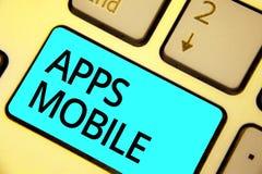 Tekstteken die Mobiele Apps tonen Conceptueel die fotocomputerprogramma wordt opgesteld om op telefoonhand te lopen - gehouden ap royalty-vrije stock fotografie
