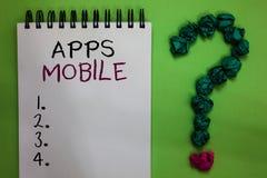 Tekstteken die Mobiele Apps tonen Conceptueel die fotocomputerprogramma wordt opgesteld om op telefoonhand te lopen - gehouden ap royalty-vrije stock afbeelding