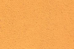 Tekstura ścienna pomarańcze Tło porowaty zdjęcia stock